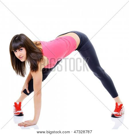 portrait of sport girl doing stretching yoga exercise, studio shot over white