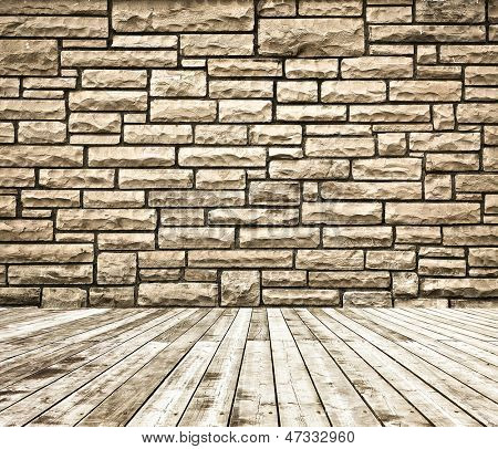 Background of aged grungy textured brown brick and stone wall with light wooden floor with whiteboard inside old neglected and deserted empty interior, blank horizontal space of clean studio room