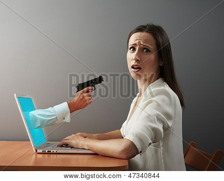 concept photo of virtual maniacs. scared woman looking at camera