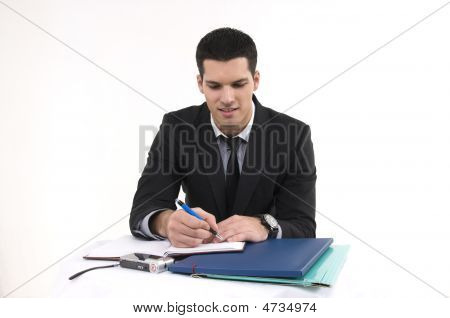 Businessman At Work With Phone And Documents