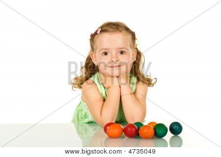 Smiling Little Girl With Easter Eggs