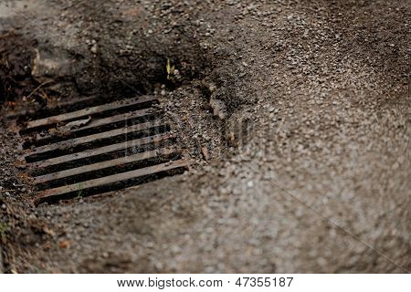 Sewage Hole On The Road