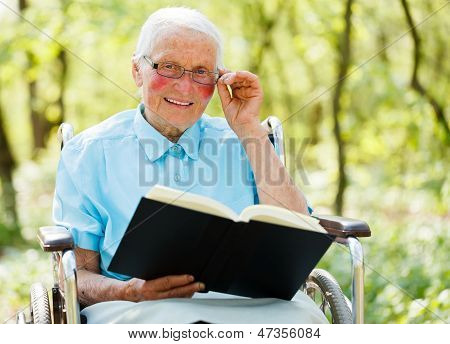 Lady In Wheelchair Reading Bible