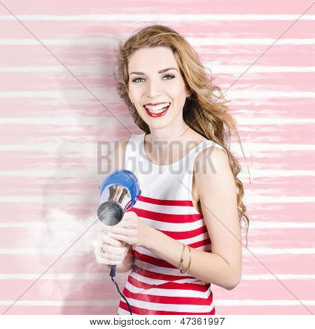 Smiling Stylist With Hair Dryer At Beauty Salon