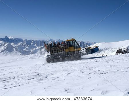 Snowcat With People