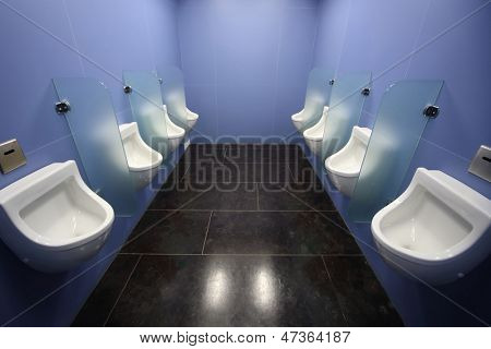 Interior of the men room with urinals