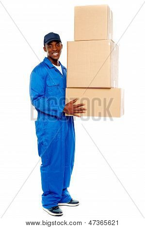 Young Delivery Boy Holding Cardboard Boxes
