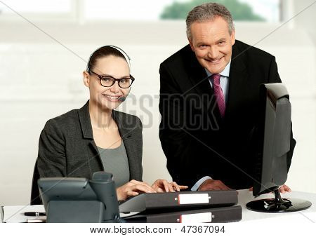 Cheerful Corporate People At Work In Office