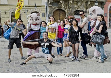 Tourists Taking Pictures With Cartoon Characters