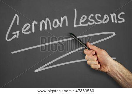 Hands In Front Of Chalkboard