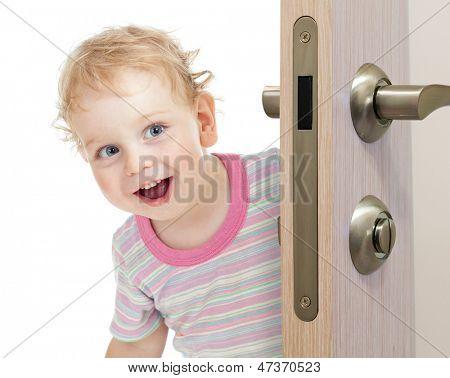 happy kid behind door