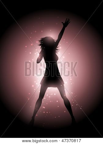 Silhouette of a female singer performing on a glowing lights background
