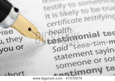 Ball pen pointing testimonial word