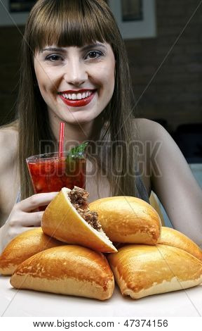 young woman eating snack