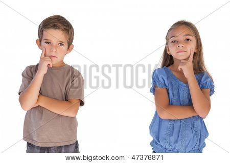 Thoughtful children standing with arms crossed on white background