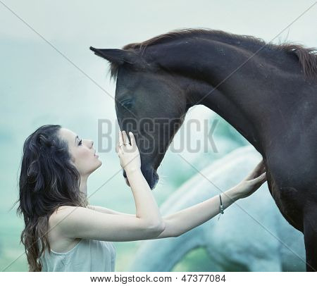 Portrait of a dark horse and woman