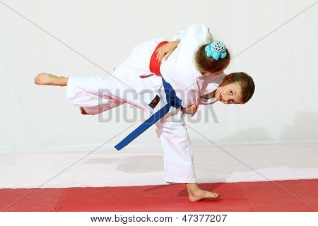 The boy throws the girl on sports training