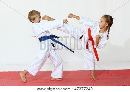 Boy in a kimono hits a hand  girl in a kimono hits foot