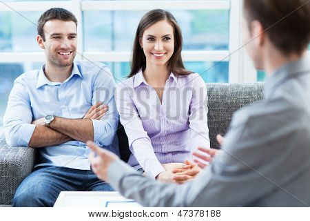 Couple meeting with financial adviser