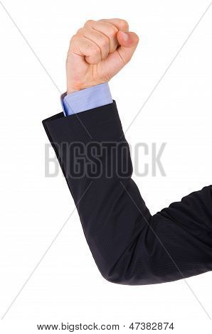Businessman arm with clenched fist.