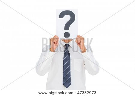 Businessman holding a paper with a question mark over face on white background