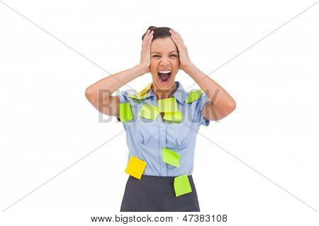 Overworked businesswoman screaming with hand on head