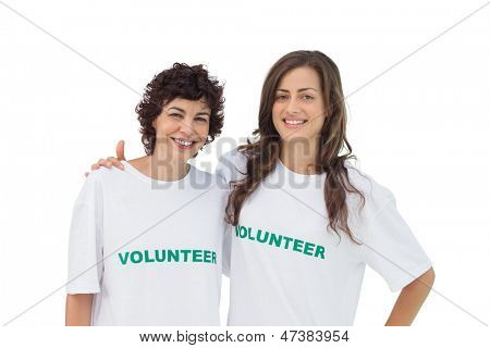 Two cheerful volunteers standing on white background