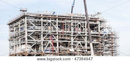 Panorama Assembling of liquefied natural gas Refinery Factory with LNG storage tank using for Oil and gas industry background