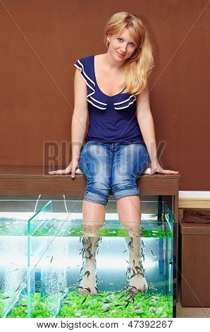 Young Girl Taking Fish Pedicure Treatment, Rufa Garra Spa Procedure