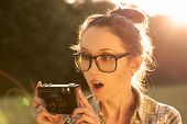 Portrait of Surprised Hipster Girl Taking a Photo