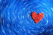 stock photo of striking  - A Red Heart moves on a Blue background - JPG