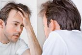 stock photo of hangover  - Sleepy man suffers from hangover in the morning - JPG