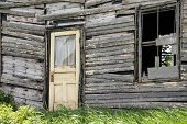 stock photo of sag  - Sagging door on a  broken down house in rural Canada - JPG