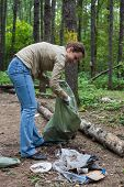 stock photo of charity relief work  - Girl helping clean up the forest in Elk Island National Park - JPG