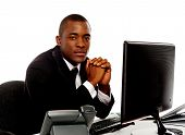 picture of thinkers pose  - Portrait of a handsome african young executive posing for camera - JPG