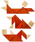pic of tangram  - three abstract figures lying down and resting  built from seven tangram wooden pieces - JPG