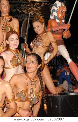 Adrianne Curry, Paula Labaredas and the models at the annual Slave Leia Group Photo at ComicCon, San Diego Convention Center, San Diego, CA. 07-23-10