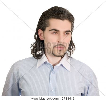 Young Serious Handsome Male Thinks Of Something Isolated White