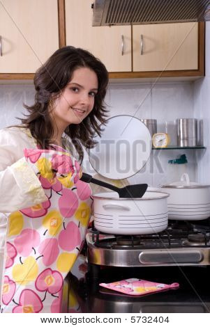 Woman cooking in pot