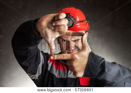 Coal Miner Looking Through A Finger Frame