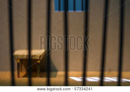 Conceptual Jail Photo With Iron Nails Bars
