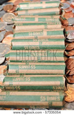 American Rolled Dimes Over Other Loose Coins