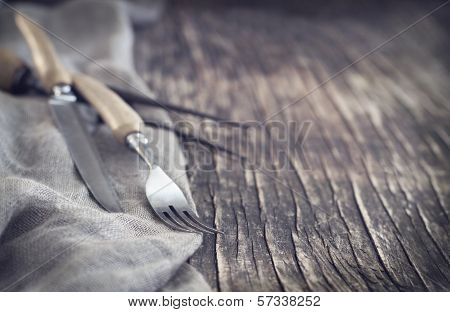 Vintage Silverware On Rustic Background, Small Depth Of Field. Toned Image
