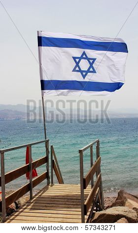Israeli Flag Against The Background Of The Red Sea