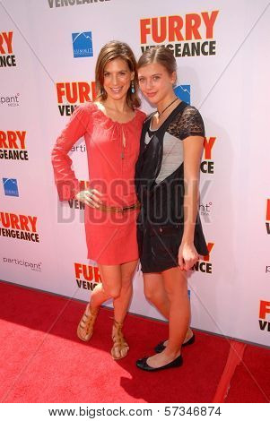 Perrey Reeves and family member at the Los Angeles Premiere of