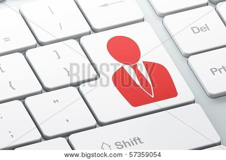 Finance concept: Business Man on computer keyboard background