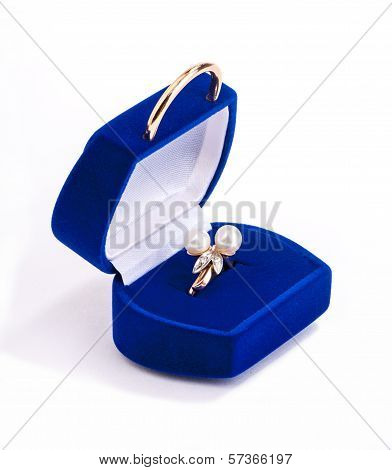 gold ring with pearls in blue velvet gift box