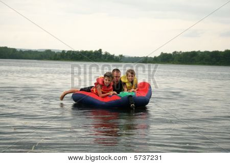 Family fun on a water tube