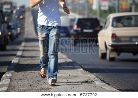 Girl Runs On Highway Middle In City, View Without Head
