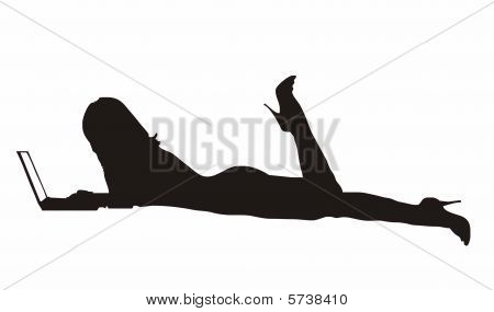 silhouette of a girl laying flat with laptop